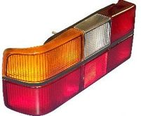 Volvo sedan, 242, 262, 264, Tail light assembly with six light panels with Black Center Molding, Left side/Driver side 1307771
